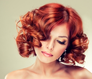 Beautiful model with red curly hair . Fashionable portrait